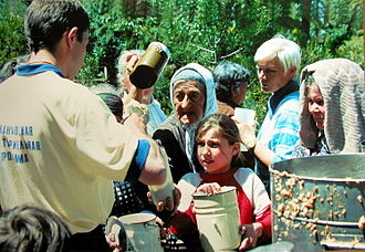 International Society for Krishna Consciousness - Member of Food for Life Russia giving food