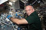 ISS-47 Jeff Williams works with the SmartCycler in the Destiny lab.jpg