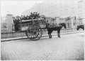 Immigrants Being Transported on Horse-Drawn Wagon, Buenos Aires, Argentina.png