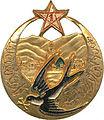 Insigne régimentaire du 1e Régiment de Tirailleurs Marocains, type 4, peint, ajouré doré.jpg