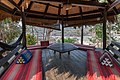 Interior of a hut with straw roof in a coffee restaurant near Li Phi Falls - Don Khon - Laos.jpg