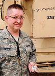 JBB sergeant coined for quick, calm actions 110702-F-GU448-001.jpg