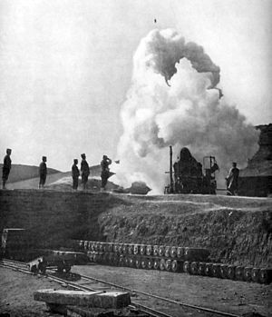 Coastal artillery - Japanese 11-inch howitzer firing; shell visible in flight