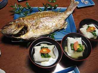 Japanese New Year - zōni, a soup with mochi and grilled fish