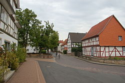 Village green (left) and the oldest timber house in the region (right)