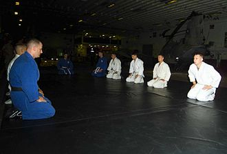 Bowing - Judo practitioner (right) performs a bow while seated in seiza.