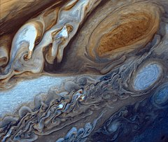 False-color detail of Jupiter's atmosphere, imaged by Voyager 1, showing the Great Red Spot and a passing white oval.