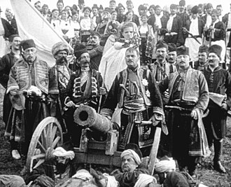 The Life and Deeds of the Immortal Vožd Karađorđe - A still from the film depicting Karađorđe (centre) as he stands amidst a large group of  followers.