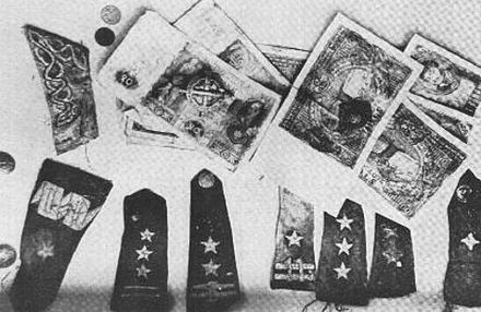 Polish banknotes and epaulets recovered from mass graves Katyn massacre 8.jpg