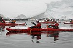 Kayakers from a very snowy photoboat. (24590091402).jpg