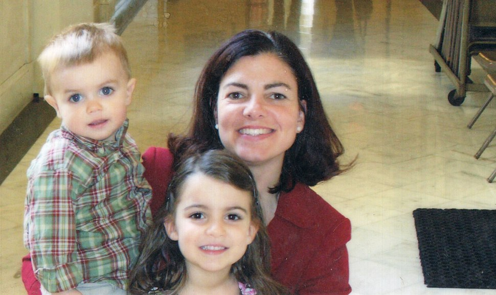 Kelly Ayotte poses with her kids, Jake and Kate, at her third and final swearing in as AG