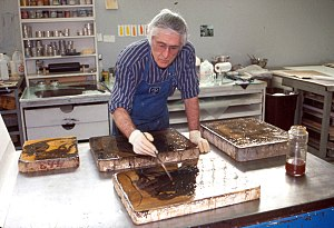 Kenneth E. Tyler - Ken Tyler processing lithography stones drawn by Helen Frankenthaler during her 'Reflections' series, Tyler Graphics Ltd., Mount Kisco, New York, 1994.