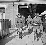 King George VI (left) with Army officers at a railway station when he arrived to inspect troops of 2nd Infantry Division at Burford-on-the-Water and Moreton-in-the-Marsh, Gloucestershire, 1 April 1942. H18399.jpg