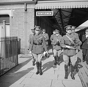 John Grover (British Army officer) - King George VI (left) with Major General John Grover (right) and several officers at a railway station at Gloucestershire, 1 April 1942.