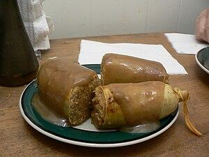 Kishka (food) - A plate of Ashkenazi-style kishka using synthetic casing
