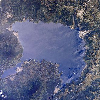 Lake Atitlán - Seen from the Space Shuttle. Volcán San Pedro is at the left of the image; Panajachel is the largest white patch along the upper right shore. North is to the top of the image.