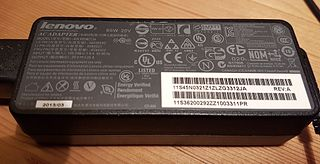 AC adapter external, enclosed power supply that converts mains electricity for an appliance