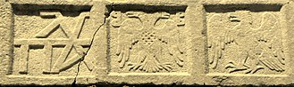 Gattilusi - Relief at the Castle of Mytilene, showing the family cypher of the Palaiologoi (left), the Byzantine double-headed eagle (centre) with the Gattilusi coat of arms on its breast, and the eagle of the Doria family (right)