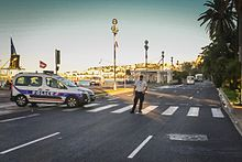The White Truck A Renault Midlum In The Distance On The Promenade Des Anglais On The Morning After The Attack