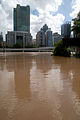 Looking across the flooded Brisbane River from GOMA and the State Library of Queensland precinct.jpg