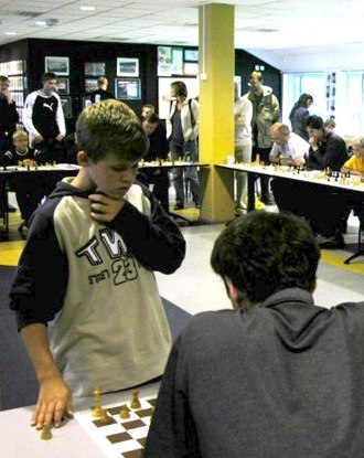 Magnus Carlsen - Carlsen, aged 13, in Molde giving a simultaneous exhibition, July 2004.