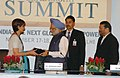 Manmohan Singh being presented a memento by the Vice-Chairperson and Editorial Director of The Hindustan Times, Shobhana Bhartia at the Hindustan Times Leadership Summit, in New Delhi on November 17, 2006.jpg