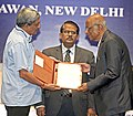 Manohar Parrikar conferring the Lifetime Achievement Award on the former DRDO Chief, Shri V. Arunachalam, at the 39th DRDO Directors' Conference, in New Delhi. The DG, DRDO, Dr. S. Christopher is also seen.jpg