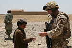 Marine Expeditionary Brigade-Afghanistan soldier establishes rapport with locals outside Bastion DVIDS186926.jpg
