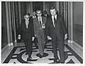 Members of Egyptian Parliament walking down a hall. May 1, 1975.jpg