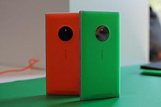Nokia Lumia 830 - Two orange and green Nokia Lumia 830 units