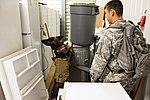 Military working dog and handler practice explosives detection 140729-A-BD610-029.jpg