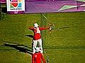Ming Chen, with arrow in flight (7745016938).jpg