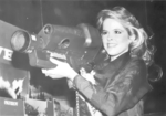 Miss Texas Laura Shaw holds Redeye missile system at Fort Bliss, Spring 1984.png