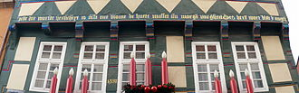 "Middle Low German - A Middle Low German inscription on a half-timbered house in Hameln, Lower Saxony, Germany: Alle der warlde herlicheyt is alse ene blome de huete wasset un morgen vorgheit. Des herrn wort blift yn ewicheit. Translation: ""All the world's magnificence is like a flower that grows today and vanishes tomorrow; the Lord's word remains in eternity."" (1 Peter 1:24-25)"