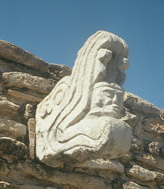 Q'uq'umatz - Ballcourt marker at Mixco Viejo, depicting Q'uq'umatz carrying Tohil across the sky in his jaws