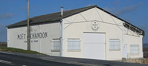 Sparkling wine production -  The larger Champagne producers have a number of press houses situated throughout the region, such as this Moët & Chandon facility.