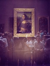 Museum visitors viewing the Mona Lisa through security glass