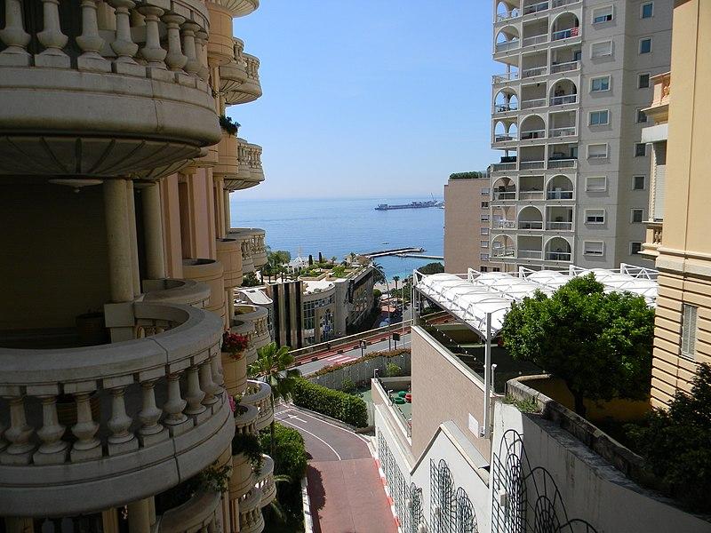 Monaco: View from La Rousse district over Larvotto district and Larvotto beach to the Rainier III Quay of Port Hercule.