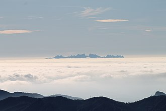 Montserrat (mountain) - Mountain seen from Puig Lluent with a sea of clouds.