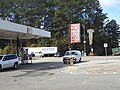 Moree's Gas Station sign and old hotel sign, GA 133, Dougherty County.JPG