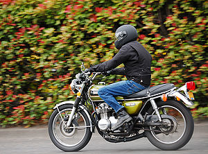 A panned shot of a motor cycle