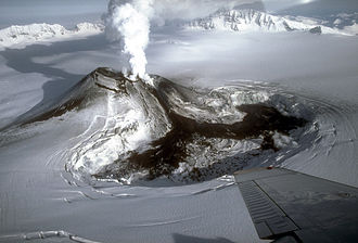 Mount Veniaminof - Steam rising from the intracaldera cinder cone at Veniaminof volcano in the waning stages of the 1983 to 1984 eruption.
