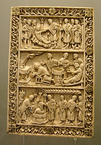 Carolingian art - Ivory plaque, probably from a book cover, Reims late 9th century, with two scenes from the life of Saint Remy and the Baptism of Clovis