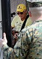 Musician Jimmy Buffet performs for members of Joint Task Force Haiti behind the U.S. Embassy in Port-au-Prince, Haiti, March 3, 2010 100303-N-HX866-003.jpg