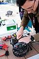 NASA Scientist Works on an A-PUFFER Robot During Trials.jpg