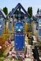 Nagrobek mężczyzny, który zginął pod kołami pojazdu - Cross from the Sӑpânţa Merry Cemetery.tif
