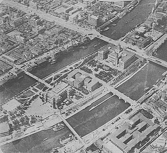 Bank of Japan - The Osaka branch of the Bank of Japan is seen in the top right of this 1930 aerial photograph. The wide street in front of the bank is part of the Mido-Suji.