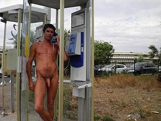 Cap d'Agde - Naked man in phone booth, Cap d'Agde, 2010