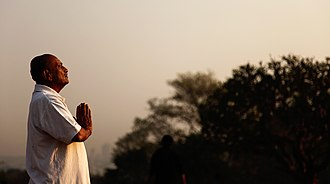 Namaste - A side view of man in Namaste pose.