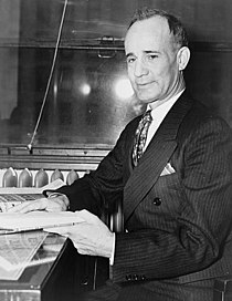 Napoleon Hill seated with book TGR.jpg